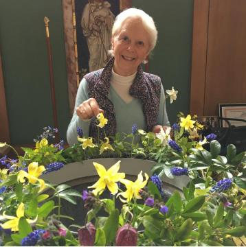 decorating the font with spring flowers
